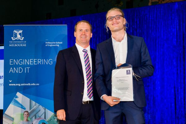 Infrastructure Engineering Best Project Award presented by Dean Prof Mark Cassidy. Project: Geothermal performance of energy screw piles in series. Team: Lawrence Hanson, Benjamin Robertson