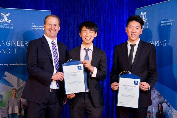 Electrical & Electronic Engineering Merit Award presented by Dean Prof Mark Cassidy. Project: AirPatcher module for wireless updates. Team: Ivan Dang, Duy To Nguyen, Jack Zheng