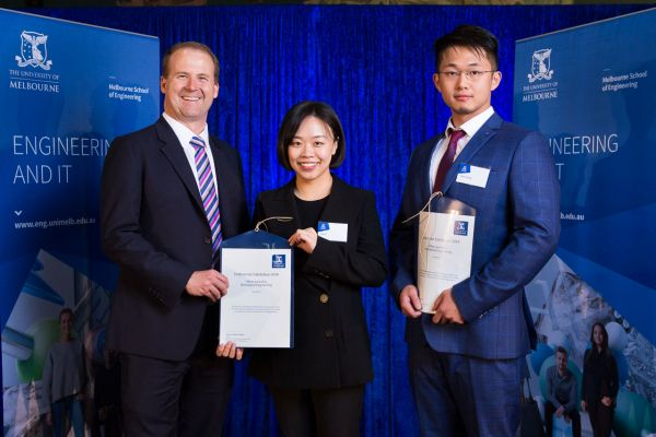 Biomedical Engineering Merit Award presented by Dean Prof Mark Cassidy. Project: Effect of crosslink density and stiffness on the chondrogenesis of MSCS in hydrogels. Team: Xin Li, Yifan Zhang