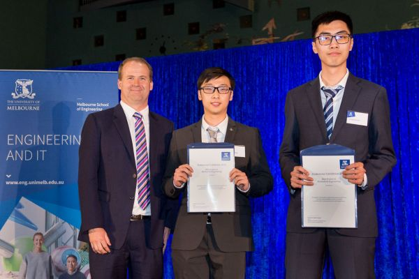 Biomedical Engineering Best Project Award presented by Dean Prof Mark Cassidy. Project: Mapping iron in the brain. Team: Chengchuan Wu, Yicheng Zhang